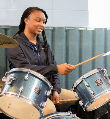 Girl playing drums.